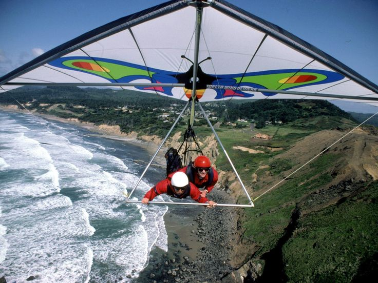 Hang-gliding... I've always wanted to fly and this is about as close as someone could get.  :)
