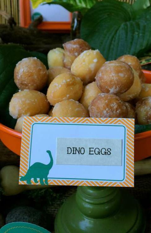 Donut dino eggs at a dinosaur birthday party!  See more party planning ideas at CatchMyParty.com!