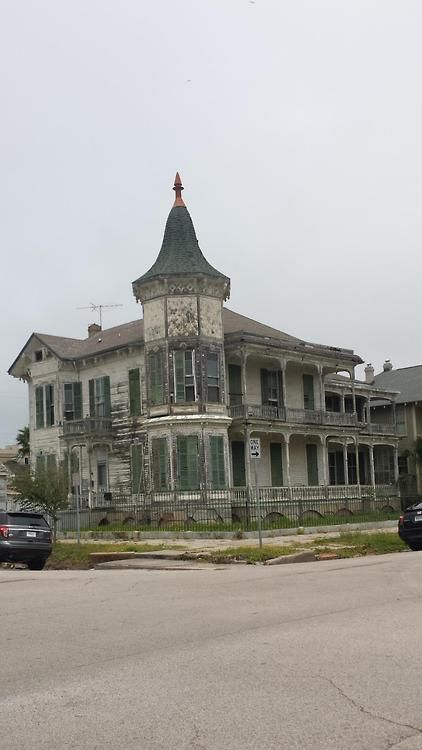 Early 1900's house abandoned on a street corner. Galveston, Texas