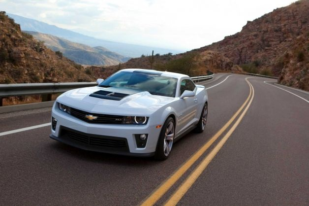 "2013 Chevrolet Camaro: You might be surprised to hear that you can get a Camaro for under $25,000. The base model will still give you plenty of performance and style. What KBB said: ""Cool is exemplified by its exterior design, which not only pays homage to previous generations of the vaunted pony car, but also thrusts it in a futuristic direction."" Base Price: $24,245 Photo: Handout, Chevrolet / Chevrolet"