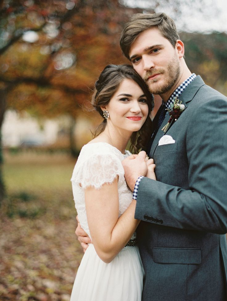 Sweet bride and groom at a fall wedding. Planning and design by Jessica Rourke, bride's dress by Grace Loves Lace, image by Landon Jacob.