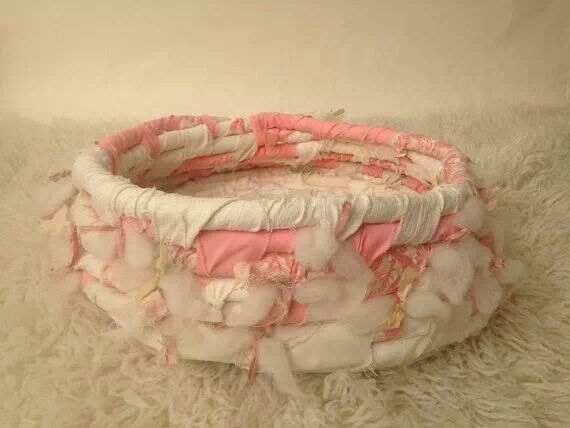 Rope basket made from fabric scraps wrapped around rope