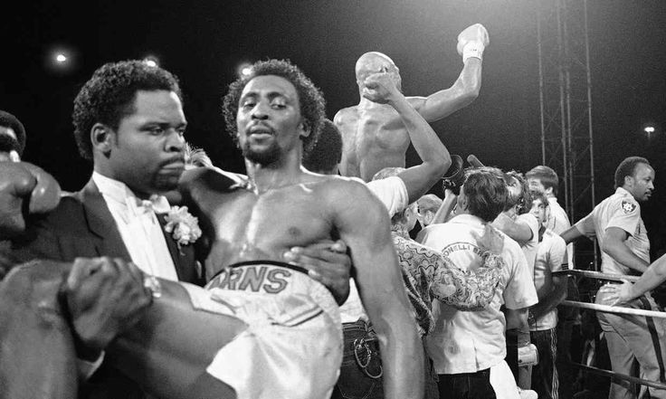 While Marvelous Marvin Hagler celebrates his victory, Thomas 'Hitman' Hearns is carried from the ring after being knocked out in the 3rd round in Las Vegas NV on April 15, 1985.