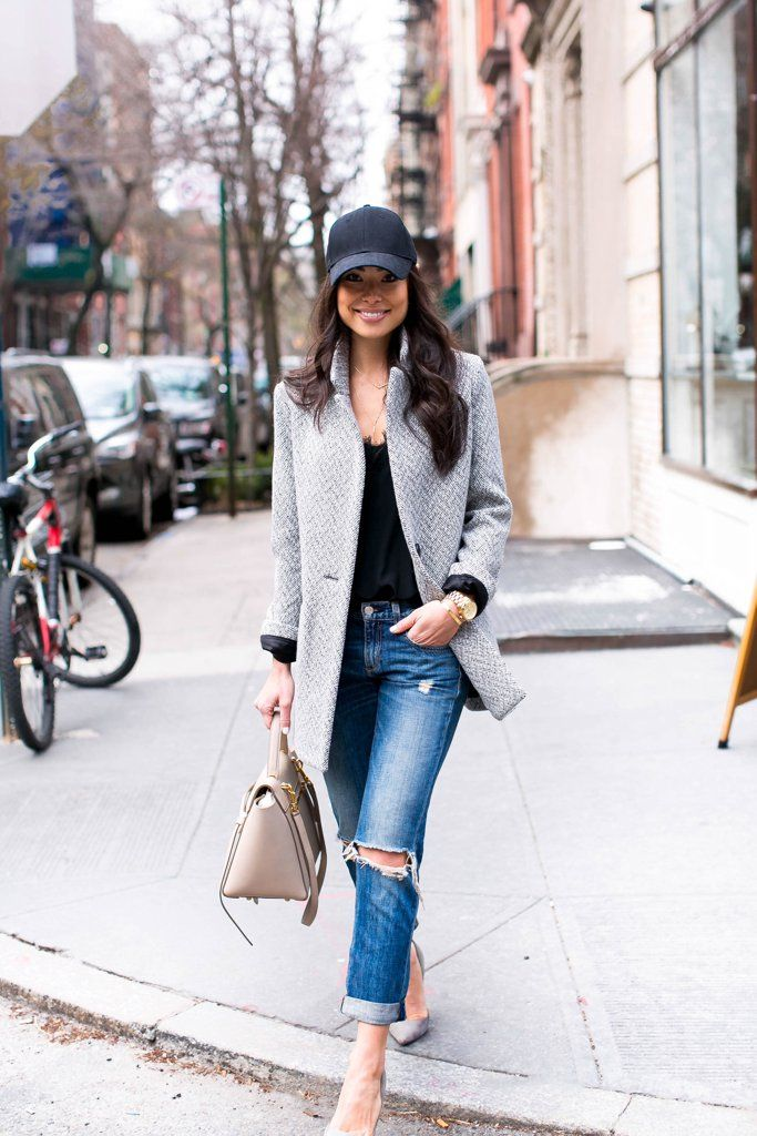 A sleek coat layered with a tee, boyfriend jeans, and a baseball hat. Elevate the look by adding heels.