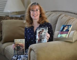 "Author feature in the Contra Costa Times: ""Author Sarah Sundin holds up a few of her eight novels she has written in Antioch, Calif., on Feb. 20, 2016. Sundin, who is a pharmacist, writes WWII Christian romance novels and has been honored for her work."" (Dan Rosenstrauch/Bay Area News Group)"