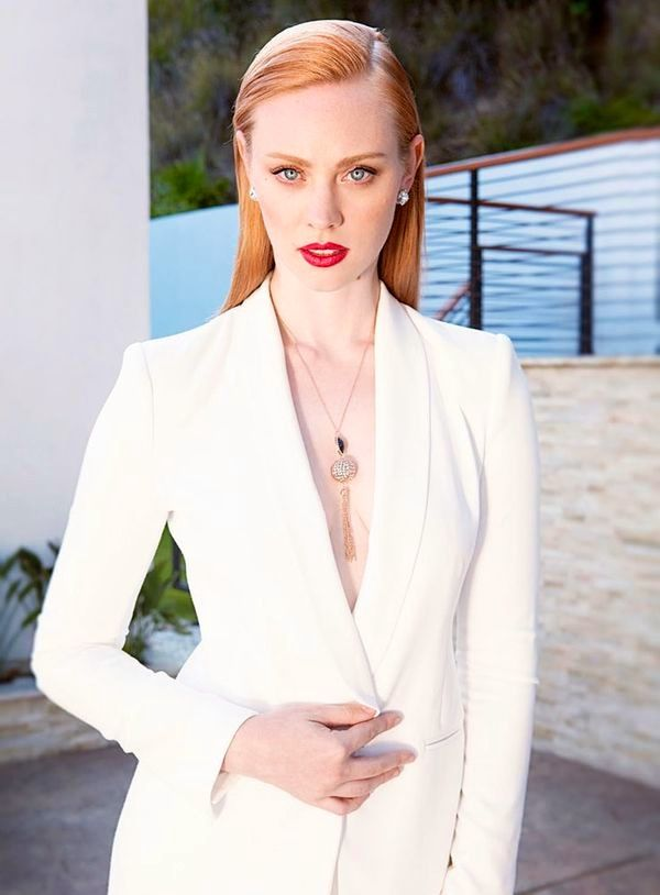 Deborah Ann Woll Looks Stunning in a Classic White Pant Suit. Red Lips and Pretty Necklace