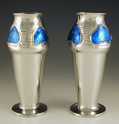 Liberty & Co. Pair of polished pewter vases with heart-shaped blue enamel plaques England c.1905