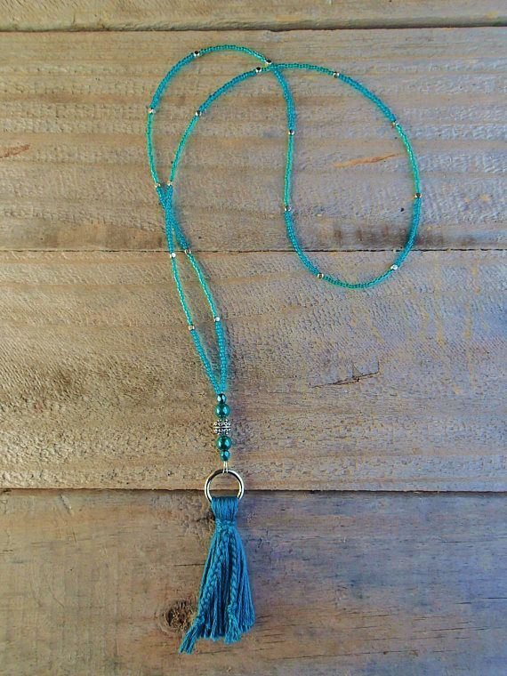 A calming combination of turquoise and teal glass seed beads, faceted crystals, and pearls create this delicate tassel necklace. Teal and turquoise colours are associated with soothing the mind and the emotions; perfect for peaceful meditation! Inspired by the Mala prayer bead style, this is a longer necklace that fits easily over your head and at approximately 24 inches (61cm) it is mid length with the tassel adding 3.5 inches to the bottom.