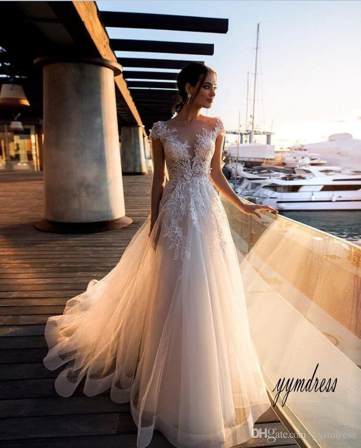 Low cost 2019 Attractive Seashore Marriage ceremony Attire Sheer Neck Cap Sleeves Lace Appliques Phantasm Again Boho Marriage ceremony Robes Bridal Attire Marriage ceremony Attire New Marriage ceremony Attire Marriage ceremony Attire From Yymdress, $122.94| DHgate.Com