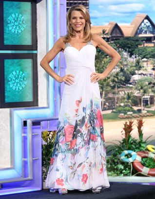 "LA FEMME Chiffon gown w/white empire bodice shirred into left waist, aurora rhinestone straps, keyhole cut-out back, full skirt w/ ""watercolor"" floral print in pink, red, green, blue 