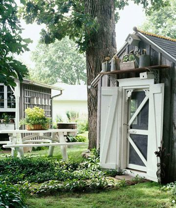 Playhouse Turned Potting Shed  Once a playhouse, this tiny building is living a new life as a garden potting shed.