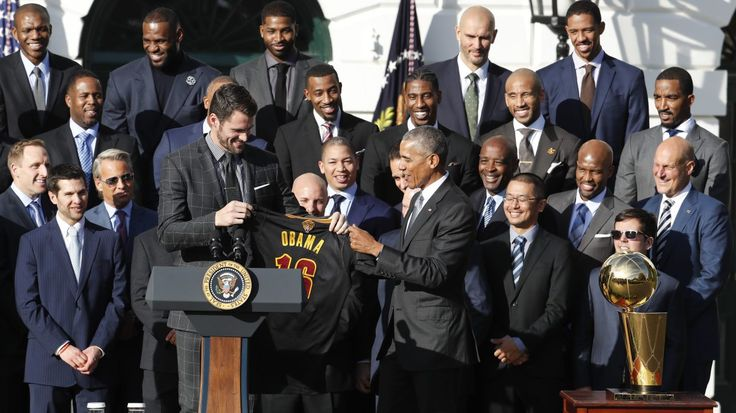President Barack Obama accepts a team basketball jersey from Cleveland Cavaliers team members Kevin Love, left, as the president honored the 2016 NBA Champions Cleveland Cavaliers basketball team during a ceremony on the South Lawn of the White House in Washington, Thursday, Nov. 10, 2016. (AP Photo/Pablo Martinez Monsivais)