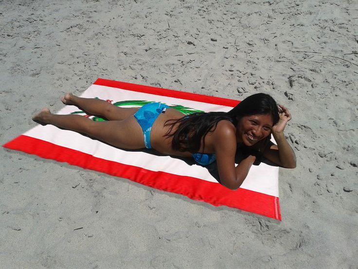 Peruvian sexi woman sunbathing on the beach.