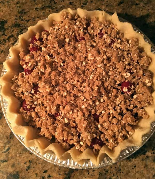 An easy cherry crumb pie made with a 24 oz jar of Trader Joe's Dark Morello Cherries in light syrup.