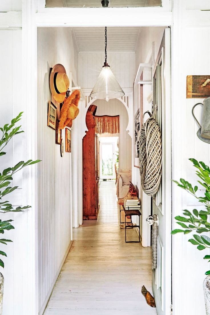 Hallway from photographer Kara Rosenlund's gorgeous Queensland workers' cottage. Photo: Steven Chee | Styling: Tahnee Carroll | Story: real living