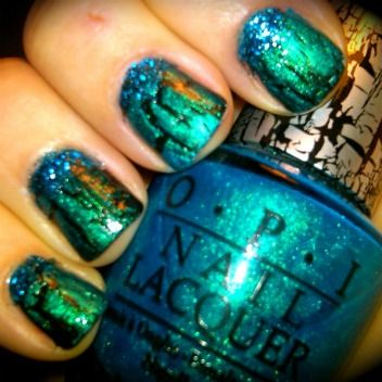 black polish with turquoise crackle and blue glitter on the moons. love it!!