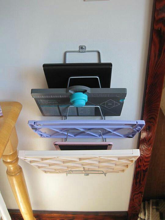 Ikea lid sorter to store scrapbooking supplies- paper cutter, scoreboard, stamp scrub, etc. Or use desk file sorter