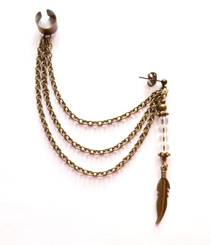 Ear cuff i brons med kedjor och bergkristall.
