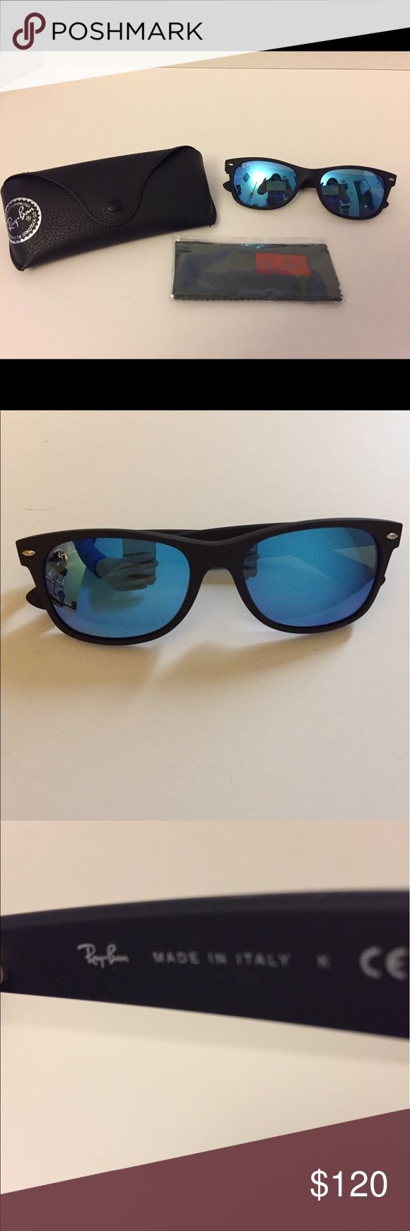 Ray-Ban New Wayfarer Blue Lenses Sunglasses Ray-Ban New Wayfarer Sunglasses with Blue Lenses.  Only Worn Once.  No Scratches! Comes with Soft Case and Cleaning Cloth. Ray-Ban Accessories Sunglasses