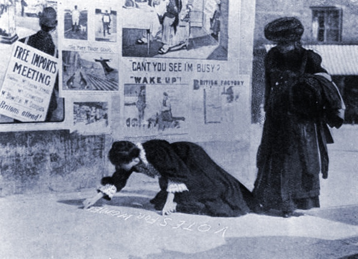 London 1907 - Suffragettes 'Chalking the Pavement.' A subversive means of communicating meeting dates and political slogans which resulted in arrests.