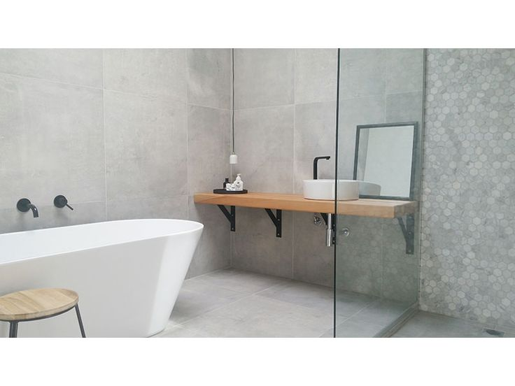 This Gorgeous Cement Look Bathroom Features The Cementia Grey 75 Tile In  Combination With A Stone Hexagon Mosaic Feature Wall, For A Stunning Effect.