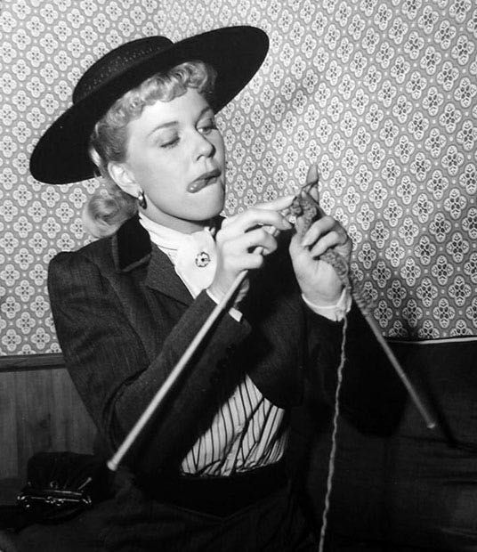 """Doris Day concentrates on her stitches on the set of """"By the Light of the Silvery Moon,"""" 1953"""