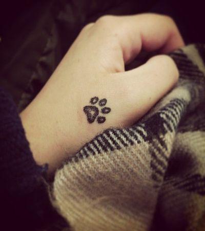 small tattoo on hand