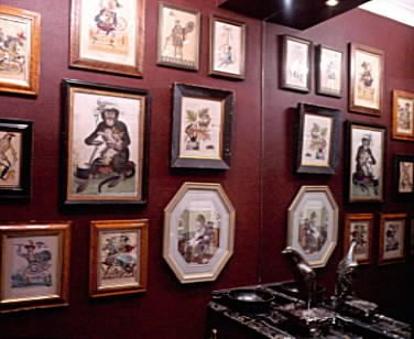 Downstairs loo with antique monkey prints on the wall.