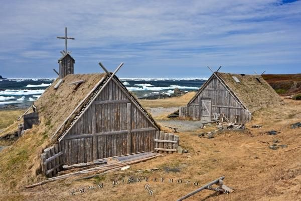 Old huts at the Norstead Viking Village L'Anse aux Meadows in Newfoundland with pack ice floating in the harbour in the backdrop @hickerphoto.com