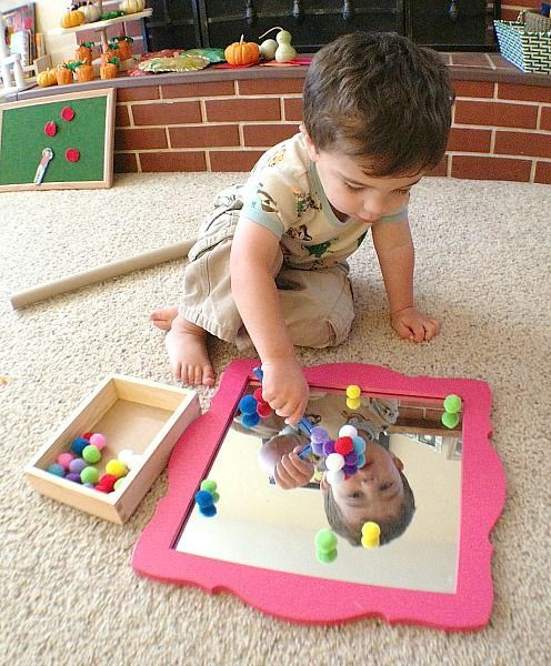 Toddler Activity: Invitation to Play with Pom Poms and a Mirror - Buggy and Buddy