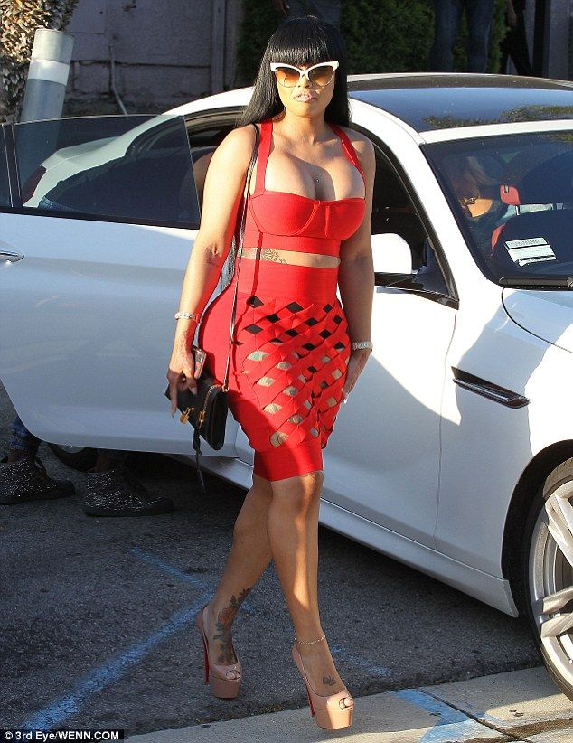 Turning heads: The 27-year-old squeezed her toned curves into a bright red two-piece, cons...
