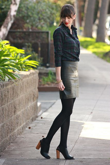 Black leather skirt, plaid shirt: