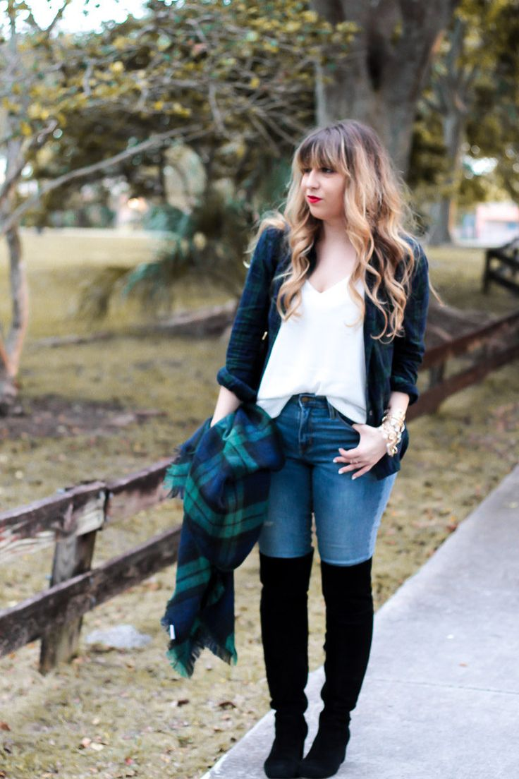 Miami fashion blogger Stephanie Pernas styles a black watch plaid blanket scarf and top with jeans and over the knee boots for a cute casual holiday plaid shirt outfit