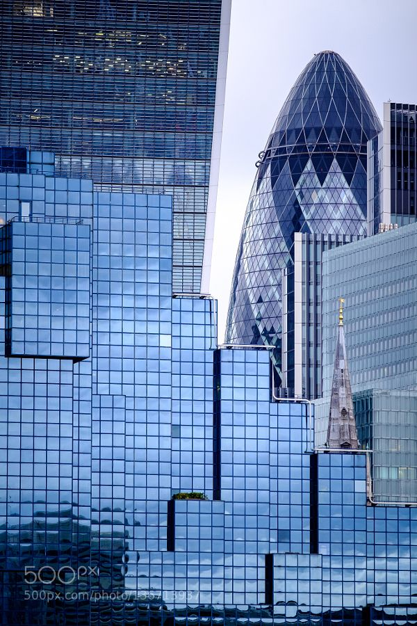 #architecturebuildingcityenglandfujifujifilmfujinonlondonpatternskyscrapertravelukurbanx-t1xf lens #Christian_Delvaux (January 19 2016 at 10:34AM) View on the buildings of the City. In front on the left side The Northern and Shell Building behind it the 20 Fenchurch Street also named Talkie Walkie due to its form. On the right the Gherkin. The church tower seen in front of Gherkin and which seems lost in the middle of the modern architecture is the Saint Margaret Patterns Church of England…