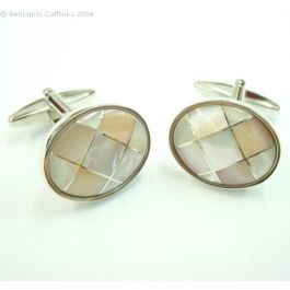 Mother of Pearl Diamonds Cufflinks - These cufflinks are made from high quality mother pearl designed as a series of framed diamond shapes set in a rhodium base.  They look fantastic with any shirt.