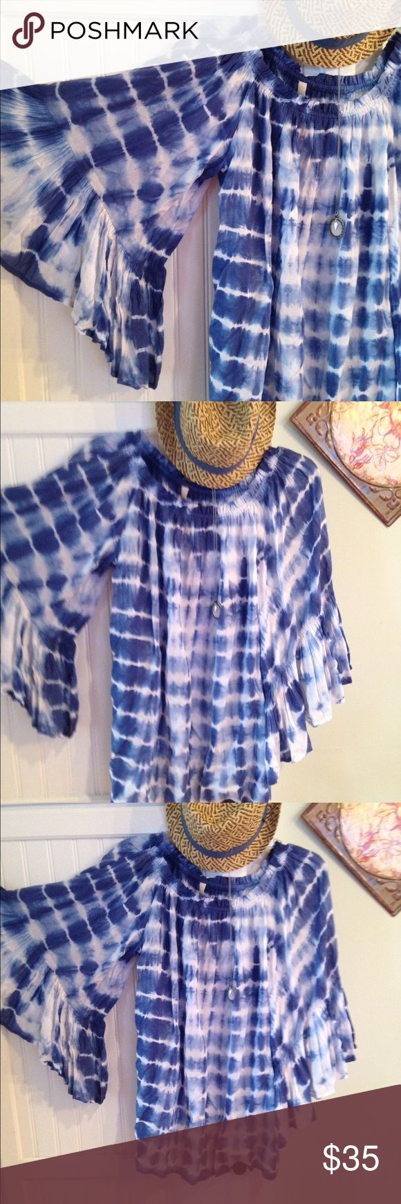 Brand new w/ tags Elan mini Dress/Tunic What a cool boho tie dyed mini dress or tunic. It has the most awesome big bell sleeves. With elastic around the top so you can wear it off the shoulder. Or with a white cami. The colors are rich beautiful blue's and white. The length is 26 1/2 inches. Hart sold separately. This is a size S. But could easily fit a M. too. Bought from Evereve elan Dresses