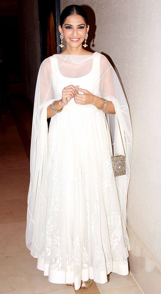 The fashion icon of B'town, Sonam Kapoor chooses to keep it simple yet elegant in this white floor-length anarkali.