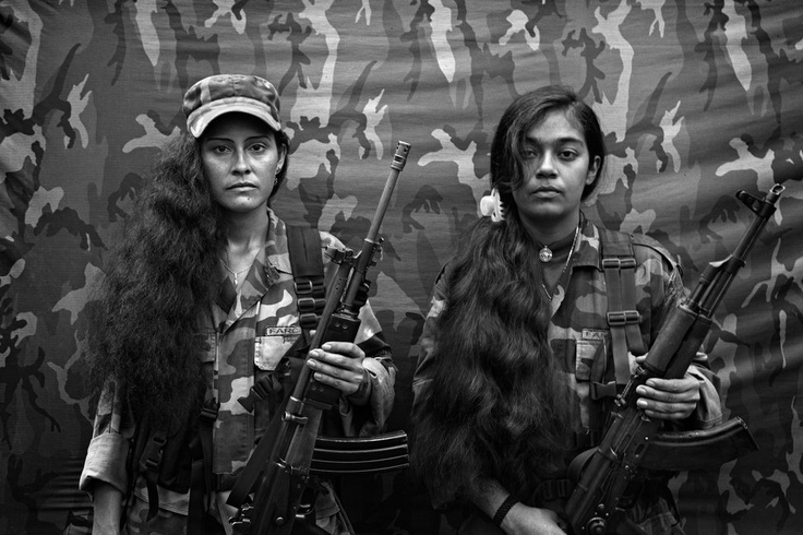 COLOMBIA - 2007: Judith and Isa, two female FARC guerrillas from the Bloque Movil Arturo Ruiz. The Bloque Movil Arturo Ruiz are a special unit of FARC (the revolutionary armed forces of Colombia) who fight as a quick reaction force. (Photo by Alvaro Ybarra Zavala, Colombian Civil War)