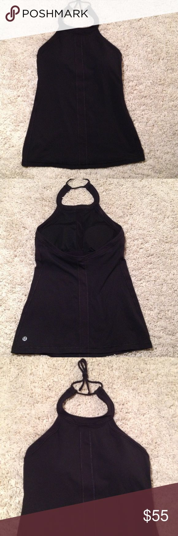 Halter workout top by Lululemon Cute workout top. No size tag so go by measurement. Chest is 26, length from neck in 20. Built in bra with removable pads. In like new condition. lululemon athletica Tops Tank Tops