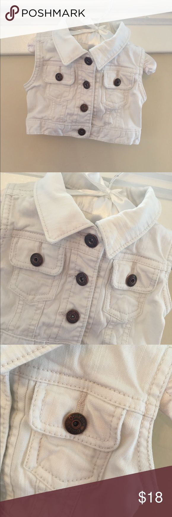 OshKosh White Denim Vest Size 12 Months OshKosh White Denim Vest Size 12 Months. Fun twist on a jean jacket! This is a perfect extra layer for spring as it goes with everything. Has four buttons in the front, and buttons in the back along the waist that can be used to adjust the size. In excellent condition! OshKosh B'gosh Jackets & Coats Vests