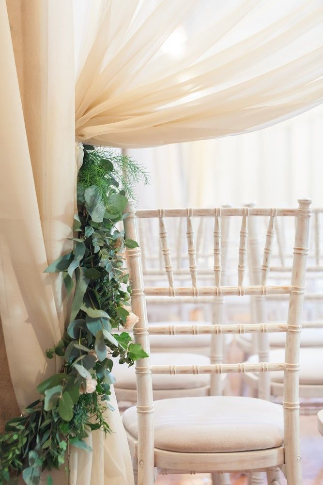 Foliage Green and chiffon drapes in the Oyster Pearl tent