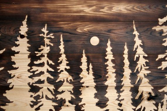 This beautiful wood burned art features a woodland skyline highlighted in the moonlight!  It is created by hand with burning techniques on a raised wood panel.  A light coat of oil has been added to nourish the wood and bring out the lovely grain. Measures 30 inches wide by 16 inches tall. Made from locally sourced, sustainably harvestable Eastern White Cedar wood. Wonderful and unique artwork for the nature lover