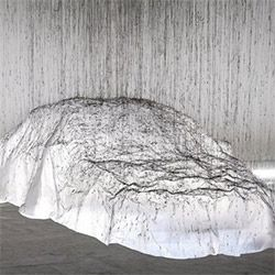 Fishing line strung along the ceiling... glue gun drizzled glue drips down... its strands sticking to the plastic sheet over the Mercedes-Benz CLA = a ghostly art piece  by Yasuaki Onishi. Beautiful making of!