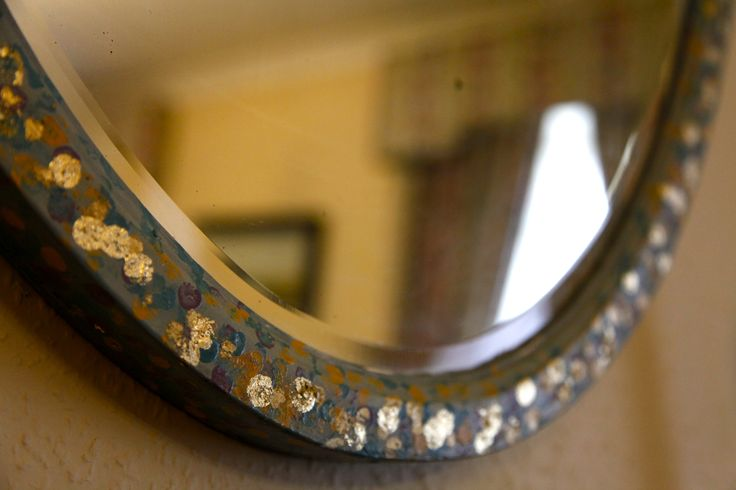 Old mirror painted with multiple Annie Sloan colours and dotted with gold leaf