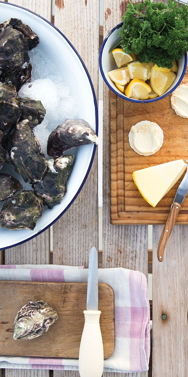 Shucking oysters at Mahurangi Oyster Farm - by Cindy Chen