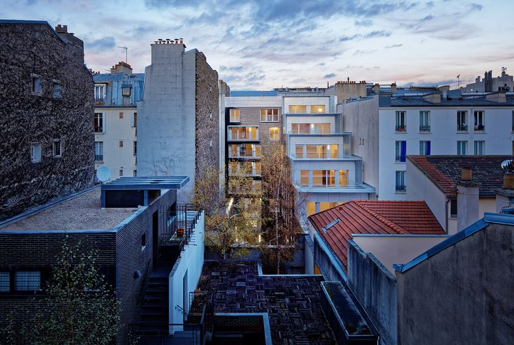 FIRM: Atelier du Pont; PROJECT: Terraced Garden, Social-housing units in Paris; LOCATION: Paris, France. Social housing block set in a traditional Parisian street of Haussmann and inner-suburb buildings. Utilizes an L-shaped configuration and staggered volumes to create semi-private terraced gardens and a public garden at  ground floor.
