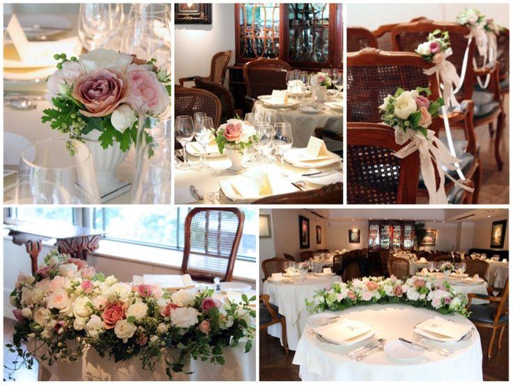 アイボリーのバラにシックなピンクを合わせた、フレンチレストランでの会場装花。 シックな色合いは茶系を基調とした落ち着いた内装にもマッチ。 クッカではお二人のご希望や会場の雰囲気に合わせて花器もその都度お選びしています。 人前式のセレモニーにはチェアフラワーとリボンでデコレーション。 [ kukka design ] 東京・三軒茶屋にあるウェディングフラワーのオーダーメイドアトリエ http://www.kukka-flowers.com