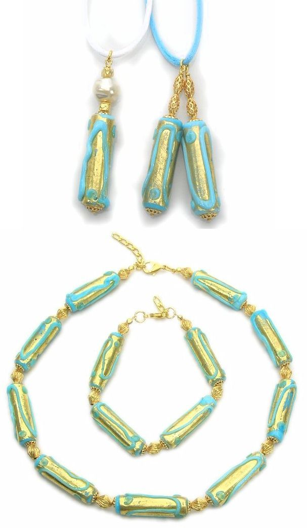 Delightful Murano glass jewelry with gold foils. Pendant with turquoise motifs and 24k gold foil, size mm.55x10. Venetian lampworkers and beadmakers make the backgrounds with gold leaf on which they apply multicolored glass jewelry decorations. Necklace made from long cylindrical turquoise glass beads (mm.35) with 24k gold foil and matching bracelet. Turquoise on gold enhances every piece of Murano glass jewellery.