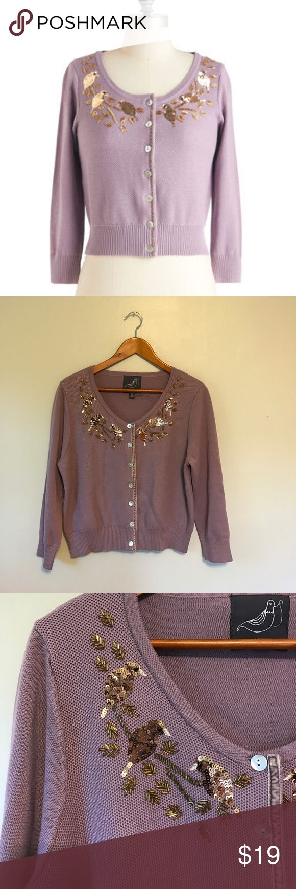 """ModCloth Knitted Dove brand cardigan with sequins NWOT there isn't a single sequin missing or out of place on this gorgeous Knitted Dove brand cardigan. This """"Good as Goldfinch"""" sweater features the beaded detail plus pearl buttons accompanied by a decorative strip of purple velvet.  Adorable sweater perfect for all seasons! ModCloth Sweaters Cardigans"""