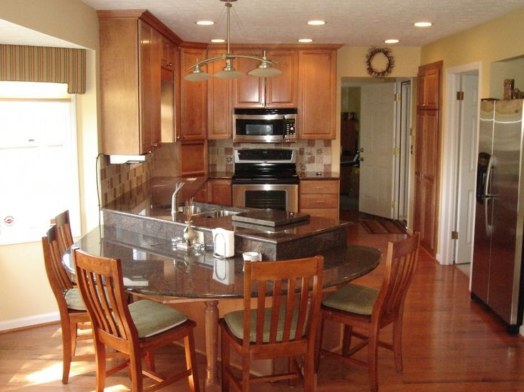 island kitchen table design with tambour appliance garage door and raised kitchen cabinet doors also